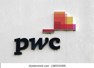 Bourg, France - April 5, 2019: PWC logo on a wall. PricewaterhouseCoopers is a multinational professional services network. It is the largest professional services firm in the world