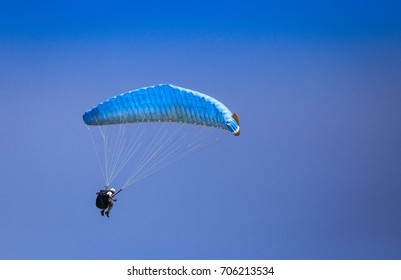 Bourgas - 30 July: Paragliding contest on the beach, July 30, 2016, Burgas, Bulgaria - Blue paraglider against blue sky background