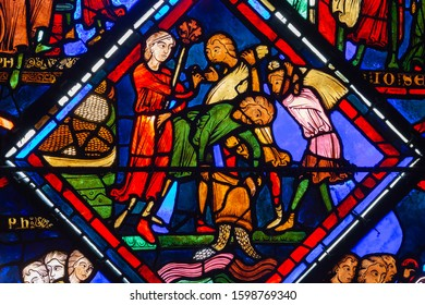 Bourges, France - november 26 2017:  Bourges cathedral stained glass - Joseph (the Patriarch) - Joseph orders grain to be poured into the Nile