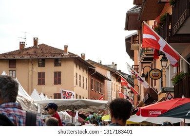 BOURG-SAINT-MAURICE, FRANCE - AUGUST 19, 2018: People shopping at traditional Agricultural and Mountain Fair market at Savoie region.
