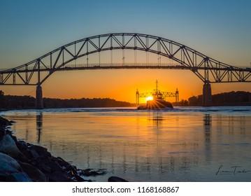 Bourne Bridge and train bridge on Cape Cod Canal, sunset