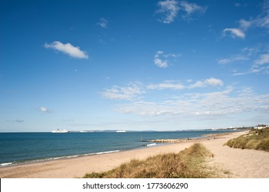 bournemouth bay sweeping beach towards poole harbour and purbecks with cruise ships aurora and arcadia in distance