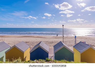 Bournemouth beach huts and sea view on a sunny day