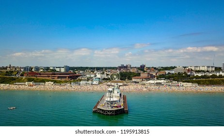 Bournemouth Beach and Pier with sunbathing in the summer