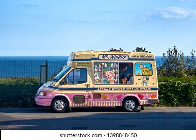 Bournemouth, Dorset / England - May 11 2019: Mr Whippy - Local Ice Cream Van selling ice creams for kids and  cold drinks. Popular tourist attraction in Bournemouth seaside town in UK