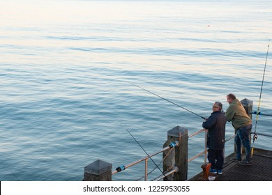 Bournemouth Dorset UK - 19 October 2018: Anglers on  Bournemouth pier