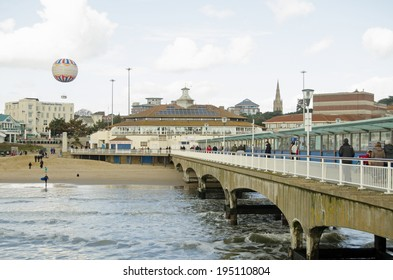 BOURNEMOUTH, ENGLAND - MARCH 1, 2014:  View from Bournemouth pier looking to beach and tethered balloon.