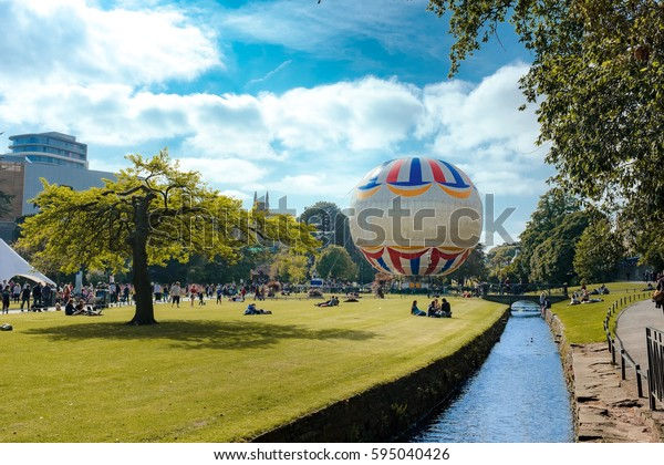 Bournemouth garden park in the summer. A lot of people are here for relax with giant balloon.