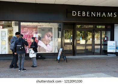 Bournemouth, UK October 25, 2018 Two men interview a Debenhams customer as the retailer announced 50 stores closure over next three to five years.