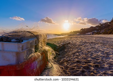 BOURNEMOUTH, UNITED KINGDOM - FEBRUARY 09: View of Bournemouth beach with fisherman's equipment during sunset on February 09, 2018 in Bournemouth