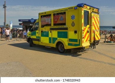 Bournemouth,UK June 02, 2020 Southwest Ambulance Service and their paramedics of National Health Service station near beach for possible emergencies as sunny and warm weather attracted large crowds