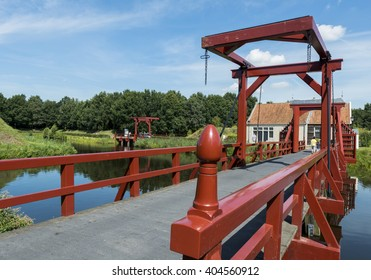 Bourtange, The Netherlands - August 12, 2012: The red drawbrifge to the entrance of fortress in the province of Groningen.