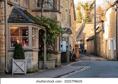 BOURTON ON THE WATER, UK - FEBRUARY 15th, 2018: Old houses and shops in Bourton-on-the-Water, which  is a village in Gloucestershire  located within the Cotswolds Area of Outstanding Natural Beauty.