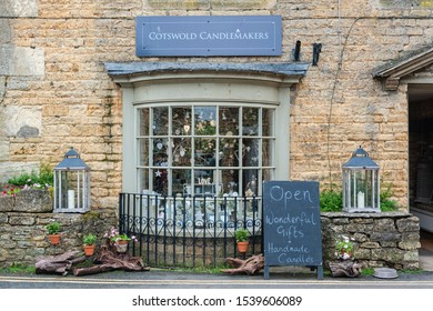 BOURTON ON THE WATER, UK - MAY 28, 2018: The front entrance of Cotswold Candlemakers shop in Bourton-on-the-Water, also known as The Venice of the Cotswolds - Gloucestershire - England UK