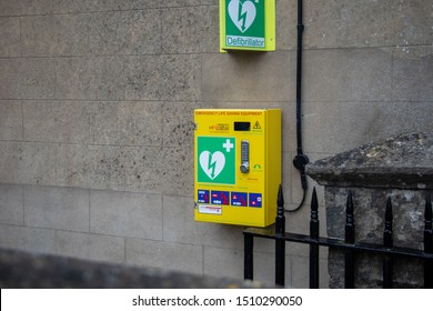 Bourton-on-the-Water, Gloucestershire / England - 09/09/2019: A defibrillator on a British street.