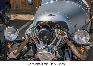 Bourton-on-the-Water, Gloucestershire UK 04/30/2019 Close up of the front of a Morgan S and S 3-Wheeler car parked in car park on a dry sunny day. No people in image. Silver body, chrome metal detail.