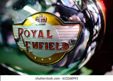 BOURTON-ON-THE-WATER, GLOUCESTERSHIRE/UK - MARCH 24 : Emblem on a Royal Enfield Motorcycle in the Motor Museum at Bourton-on-the-Water in Gloucestershire on March 24, 2017