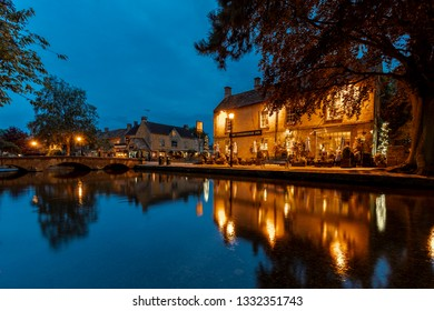BOURTON-ON-THE-WATER/GLOUCESTERSHIRE/ENGLAND-AUGUST/28/2018  Bourton on the water and a village pub reflections in the river Windrush.