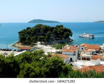 Bourtzi in Skiathos Island in the Aegean Sea and several buildings of Skiathos town, Greece