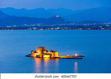 Bourtzi water fortress in Nafplio at night. Nafplio is a seaport town in the Peloponnese peninsula in Greece.