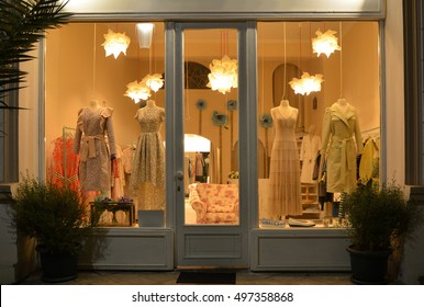 Boutique display window with mannequins in elegant dresses