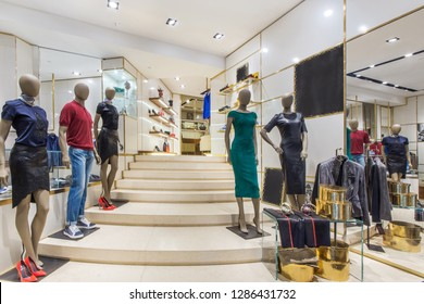 Boutique salon with different stylish fashionable clothes and shoes. Fashionable clothes in boutique