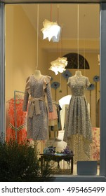 Boutique window with mannequins in dresses