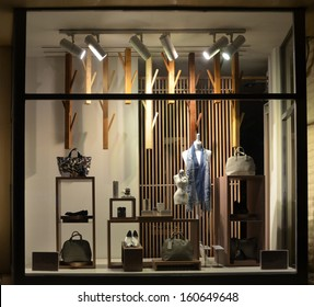 Boutique window with shoes, bags and mannequin