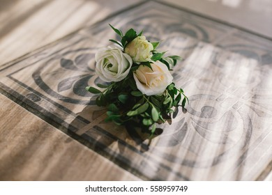 boutonniere of white roses for groom