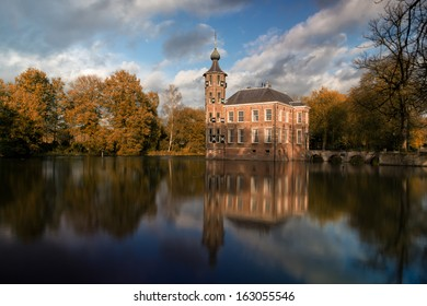 Bouvigne castle, one of the monuments in the city of Breda, the Netherlands, on a sunny autumn day with the building reflected in the water