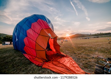 BOUZOV, CZECH REPUBLIC - AUGUST 18, 2018: Pictures of hot air balloons starting from the field near of the Bouzov castle at sunset. This festival repeats every year at the end of summer.