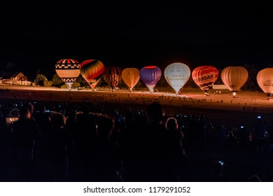BOUZOV, CZECH REPUBLIC - AUGUST 18, 2018: Pictures of hot air balloons show near of the Bouzov castle at night. This festival repeats every year at the end of summer.