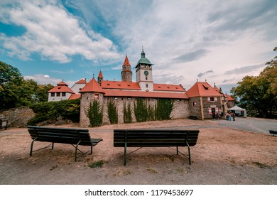 BOUZOV, CZECH REPUBLIC - AUGUST 8, 2018: Picture of visitors waiting at the Bouzov castle at night.