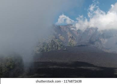 the Bove Valley flooded by clouds in Etna Park, Sicily