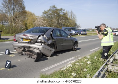 BOVENKARSPEL, THE NETHERLANDS MAY 5 2016: Police taking pictures, pictures of a damaged car after an accident on may 5 ,2016 in bovenkarspel, holland