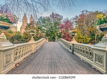 The Bow Bridge  is a cast iron bridge located in Central Park, New York City, crossing over The Lake in autumn