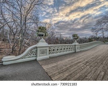 Bow bridge in winter at dawn with clouds and sun rising