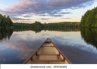Bow of a canoe on a lake - Haliburton, Ontario, Canada
