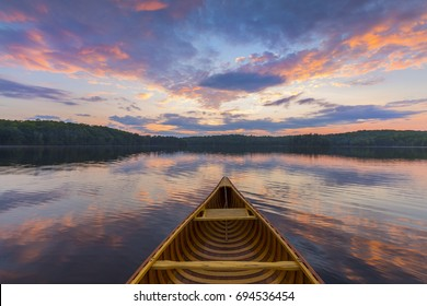 Bow of a cedar canoe on a lake at sunset - Haliburton, Ontario, Canada