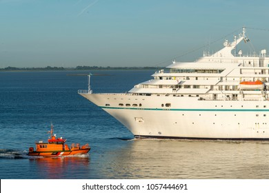 Bow of a cruise ship and a pilot boat in the harbor of Bremerhaven, Germany