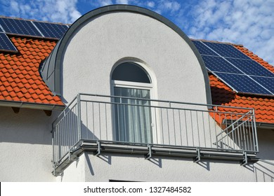 Bow Dormer Window with high grade Steel handrailed Balcony at a residential Building