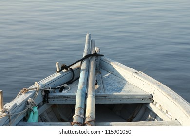Bow of a fishing boat with paddles