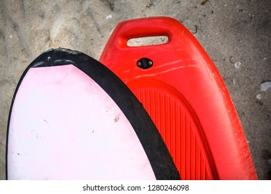 Bow the Forward End of kayak on a Coarse Sand. Front Part of Dark Orange Water Boat. Flotation Bag in White on Top of Watercraft. Watersport Adventure Ideas.