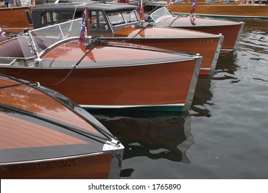 Bow of Four Antique Wooden Boats Abreast
