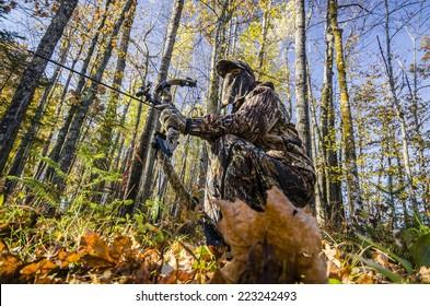 bow hunter crouching