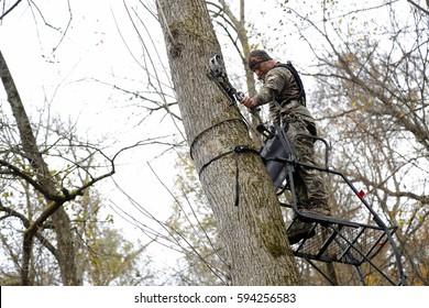 Bow hunter tree stand ladder climb