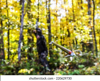 bow hunters flying arrow