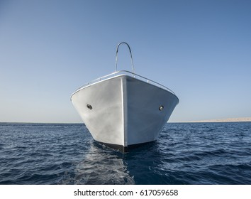 Bow of large luxury motor yacht sailing at sea on tropical ocean