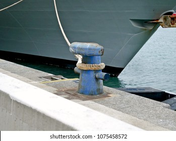 The bow of the military ship with rope and bollard.