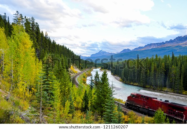 Bow River and Freight train  in autumn, Banff National Park, Canadian Rockies, Alberta, Canada